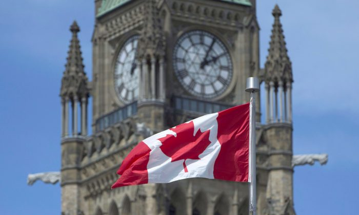 The maple leaf flies in front of the Peace Tower on Parliament Hill on May 6, 2016, in Ottawa. (The Canadian Press/Adrian Wyld)