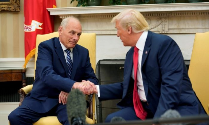President Donald Trump shakes hands with John Kelly after he was sworn in as White House Chief of Staff in the Oval Office of the White House on July 31, 2017. (REUTERS/Joshua Roberts)