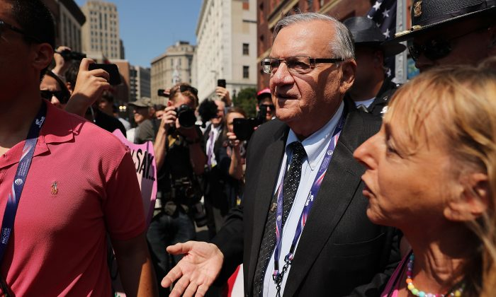 Maricopa County Sheriff Joe Arpaio is surrounded by protesters and members of the media at the the site of the Republican National Convention (RNC) in downtown Cleveland on the second day of the convention in Cleveland, Ohio on July 19, 2016. (Spencer Platt/Getty Images)