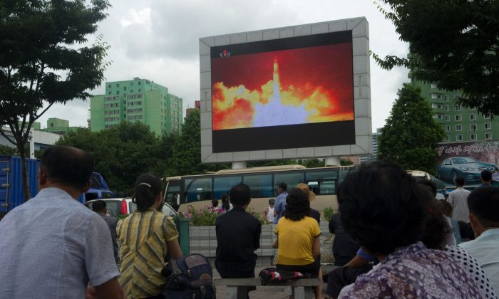People watch as coverage of an ICBM missile test is displayed on a screen in a public square in Pyongyang on July 29, 2017. Kim Jong-Un boasted of North Korea's ability to strike any target in the US after a second ICBM test that weapons experts said on July 29 could even bring New York into range. (KIM WON-JIN/AFP/Getty Images)