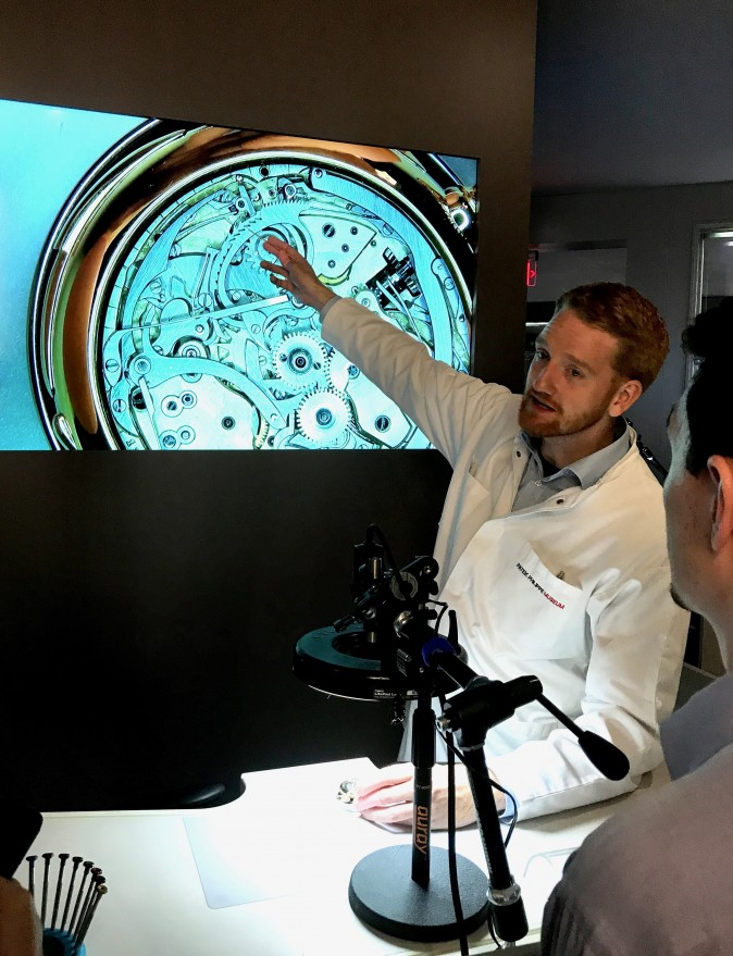 A watchmaker demonstrates how the movement of a mechanical watch works at The Art of Watches Grand Exhibition of Patek Philippe in New York on July 13, 2017. (Milene Fernandez/The Epoch Times)