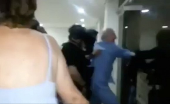 A still image taken from a social media video said to show the moment in which former Caracas Mayor Antonio Ledezma (in blue) is led under arrest from his home, in Caracas, Venezuela August 1, 2017. )Social Media/Handout via Reuters)