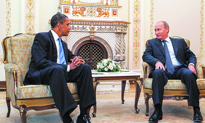 President Barack Obama speaks with Russian Prime Minister Vladimir Putin in Novo-Ogarevo, outside Moscow, on July 7, 2009. (ALEXEY/DRUZHININ/AFP/GETTY IMAGES)