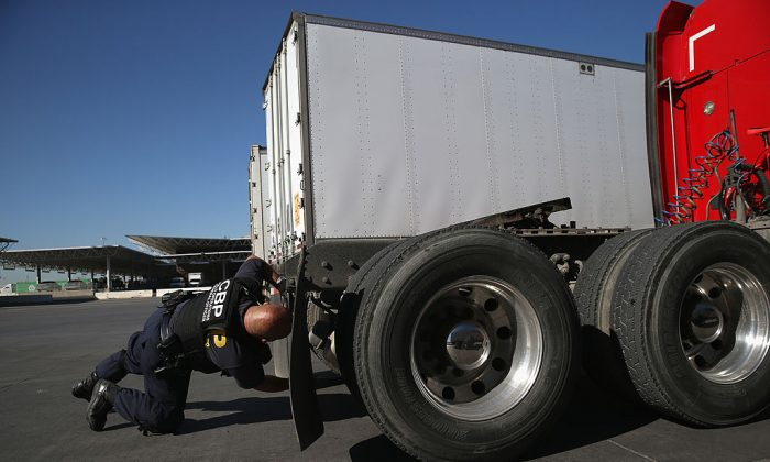 A U.S. Customs and Border Protection inspects a truck coming from Mexico into the United States at the Otay Mesa port of entry on November 14, 2013 in San Diego, California. Otay Mesa is the second busiest cargo port in the southwestern United States, with some 750,000 trucks passing through annually. (Photo by John Moore/Getty Images)