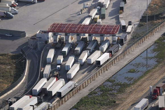 Freight trucks, as seen from a helicopter, pass through Mexican Customs before entering the United States at the Otay Mesa port of entry on May 11, 2017 in San Diego, California. President Donald Trump has vowed to renegotiate the North American Free Trade Agreement (NAFTA), and reduce the U.S. trade deficit with Mexico. The border spans almost 2,000 miles from the Gulf of Mexico to the Pacific Ocean and is fenced for some 700 miles of it's total length.  (Photo by John Moore/Getty Images)