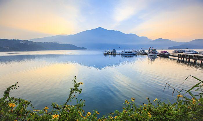 Sun Moon Lake before sunrise. (Ivy Weng/Shutterstock)
