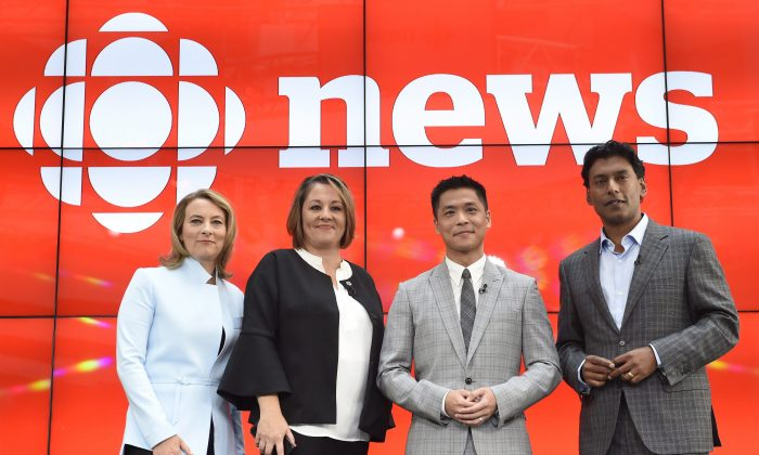 """(L-R) Adrienne Arsenault, Rosemary Barton, Andrew Chang, and Ian Hanomansing are named the new hosts of """"The National"""" at a news conference in Toronto on Aug.1, 2017. (The Canadian Press/Nathan Denette)"""