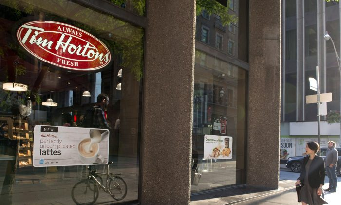 Restaurant Brands International says it has signed a deal with a joint venture partner to take Tim Hortons to Spain. (The Canadian Press/Doug Ives)