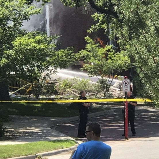 Police stand next to a cordon outside the Minnehaha Academy, after part of the Christian private school collapsed, in Minneapolis, United States August 2, 2017 in this image obtained from social media.  Adam Carter/WCCO RADIO/via REUTERS