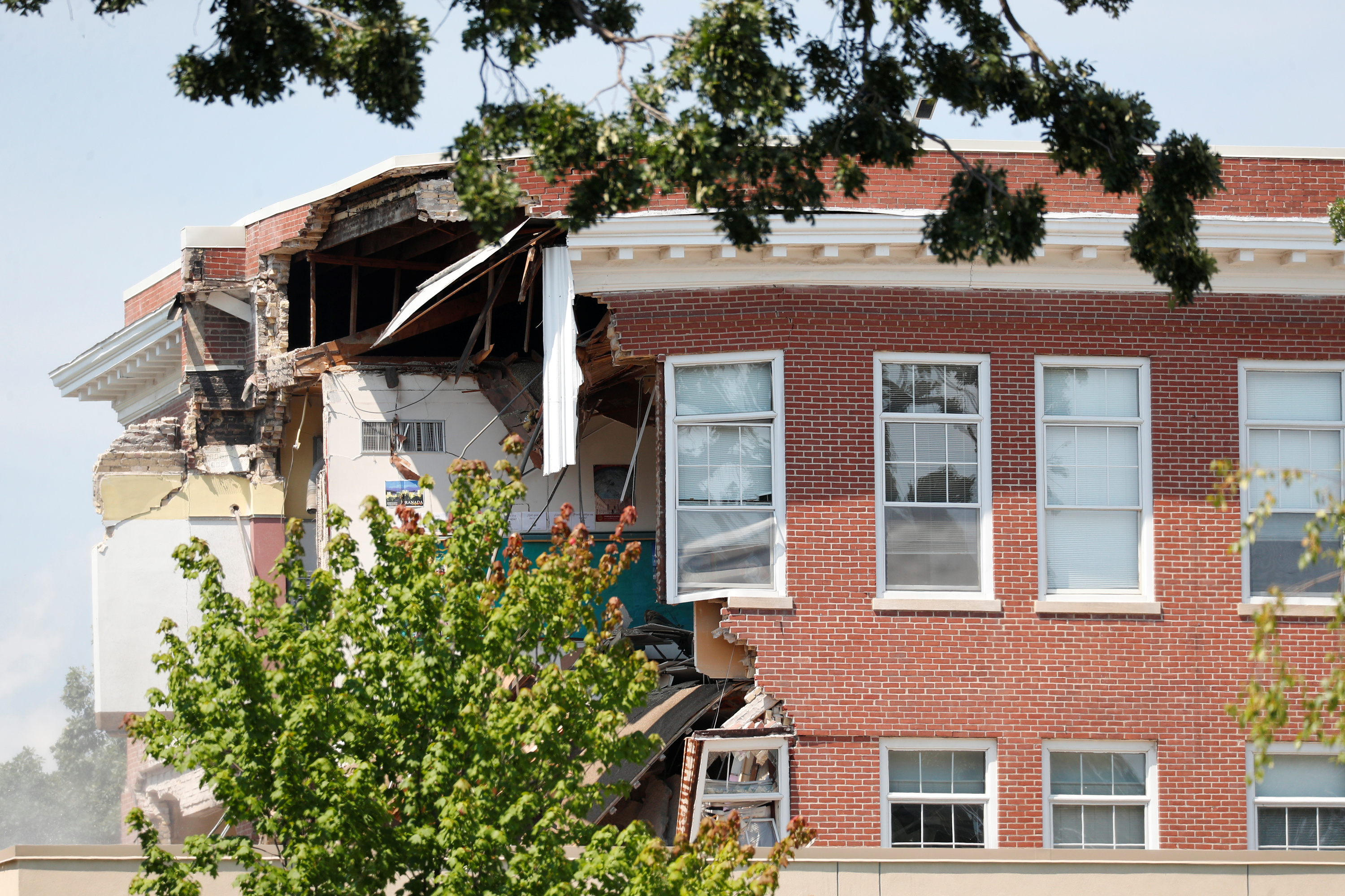 Damage to the building is seen as emergency personnel work the scene of school building collapse at Minnehaha Academy in Minneapolis, Minnesota on Aug. 2, 2017. (REUTERS/Adam Bettcher)