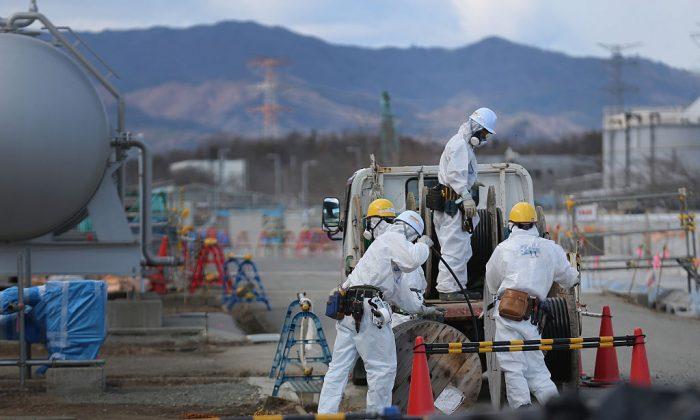 Workers continue the decontamination and reconstruction process at the Tokyo Electric Power Co.'s embattled Fukushima Daiichi nuclear power plant in Okuma, Japan on Feb. 25, 2016. (Christopher Furlong/Getty Images)