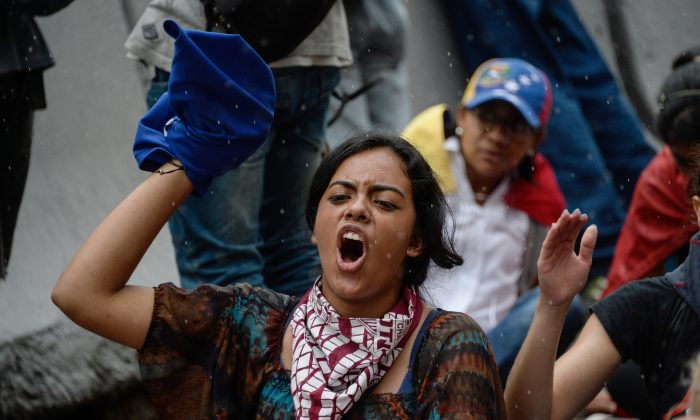 Opposition activists protest against the government in Caracas, Venezuela, on May 12. (FEDERICO PARRA/AFP/Getty Images)
