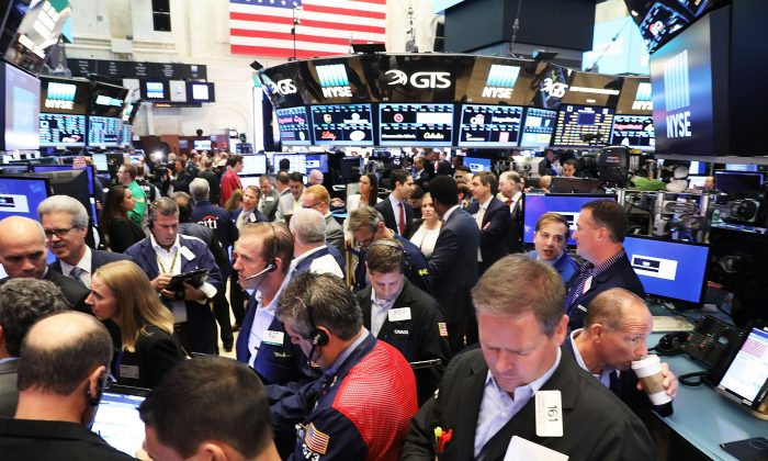 Traders work on the floor of the New York Stock Exchange (NYSE) on June 30. (Spencer Platt/Getty Images)