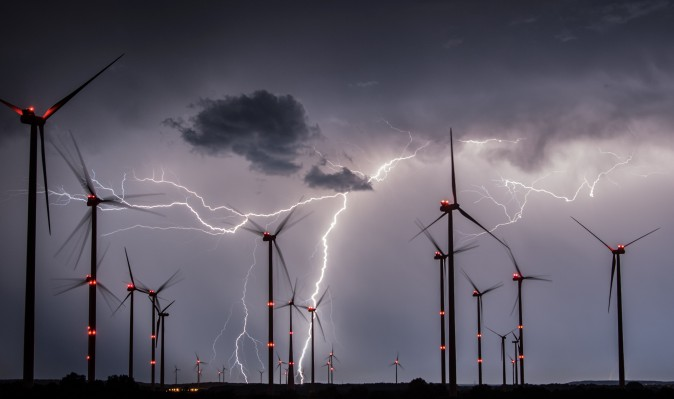 Lightnings flash over windmills of the Odervorland wind energy park near Sieversdorf, eastern Germany, on August 1, 2017. / AFP PHOTO / dpa / Patrick Pleul / Germany OUT (Photo credit should read PATRICK PLEUL/AFP/Getty Images)