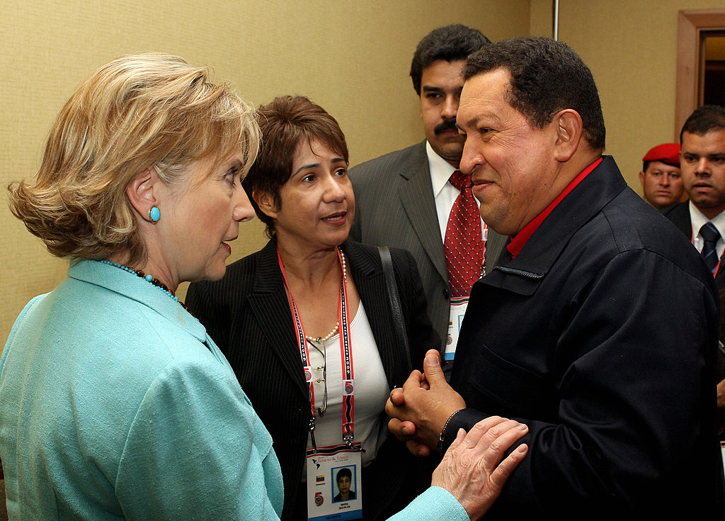Venezuelan President Hugo Chavez (R) listens to US Secretary of State Hillary Clinton before the family picture during the Summit of the Americas at the Hyatt Regency in Port of Spain, Trinidad April 18, 2009.    (PRESIDENCIA/AFP/Getty Images)