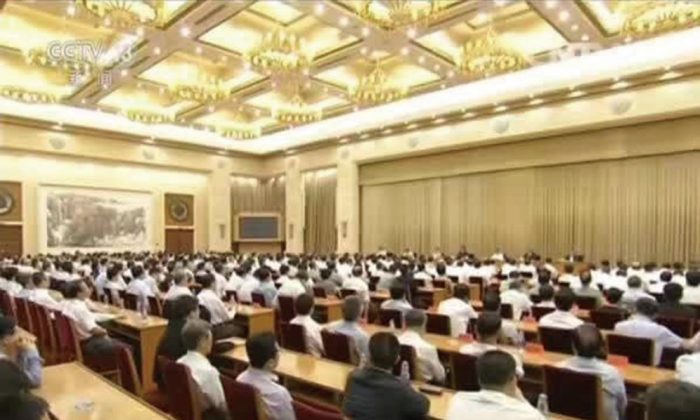 Party officials gathered in Beijing for an emergency meeting on July 26 and 27. (CCTV)
