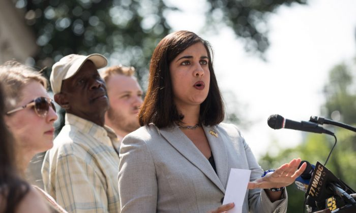 Nicole Malliotakis, Republican New York City mayoral candidate, holds up a letter demanding information about Mayor Bill De Blasio's foreign travel while speaking during a press conference outside City Hall, in New York City on July 19, 2017. (Drew Angerer/Getty Images)