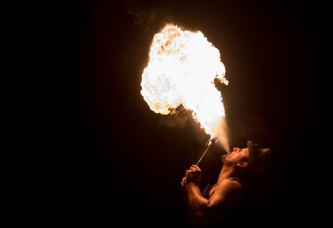 Fire eater Antonio Russell performs in Big Top at the Gerry Cottle's Magic Circus in Devon, England, on August 1, 2017. (Matt Cardy/Getty Images)
