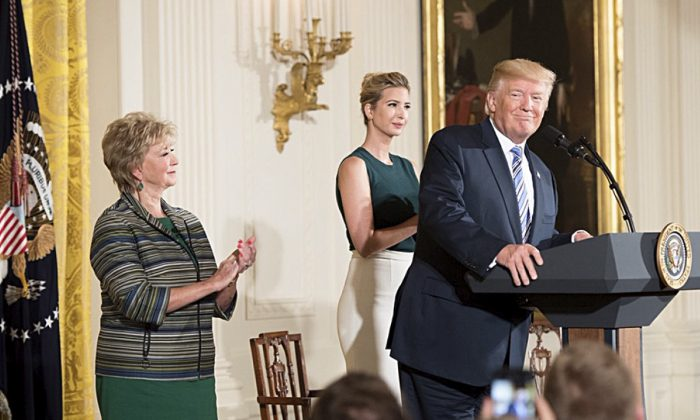 President Donald Trump, daughter and senior adviser Ivanka Trump,,and Small Business Administration head Linda McMahon (L) at an,event for small businesses at the White House on Aug. 1, 2017. (The White House)