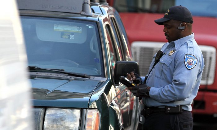 A San Francisco Department of Parking and Traffic issues a parking ticket for an illegaly parked car on January 21, 2011 in San Francisco, California. (Justin Sullivan/Getty Images)