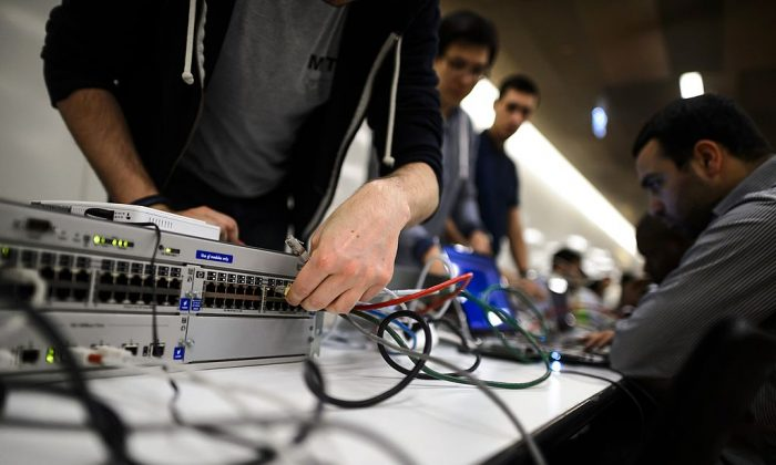 Ethical hackers at conference. (FABRICE COFFRINI/AFP/Getty Images)
