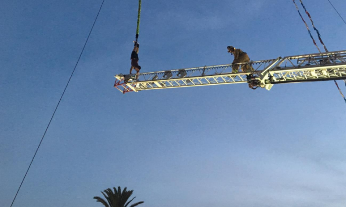 Roger Rodriguez, 19, is rescued by Ventura City fire fighters after his bungee jump at the Ventura City County Fair left him hanging, trapped, for 20 minutes. (Ventura City Fire Dept.)