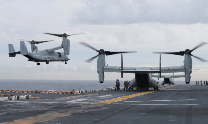 U.S. Marine MV-22B Osprey aircraft land on the deck of the USS Bonhomme Richard amphibious assault ship during events marking the start of Talisman Saber 2017, a biennial joint military exercise between the United States and Australia, off the coast of Sydney, Australia on June 29, 2017. (REUTERS/Jason Reed)