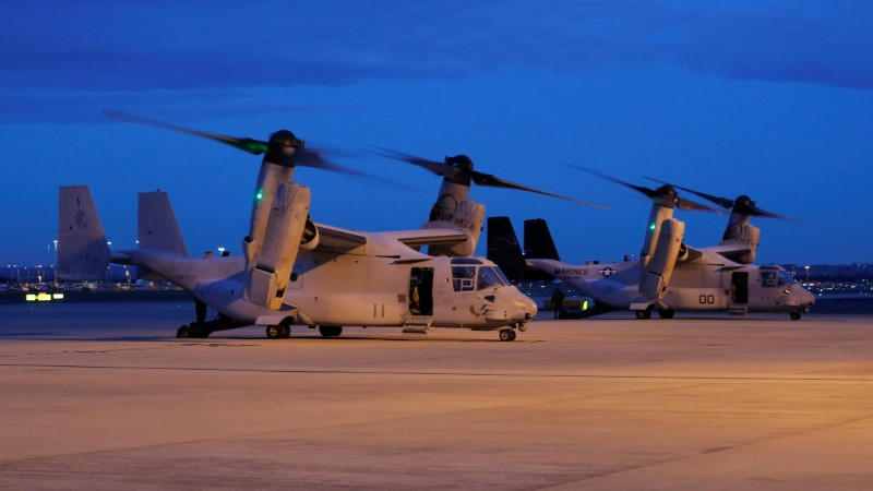 Two U.S. Marines MV-22 Osprey Aircraft sit on the apron of Sydney International Airport in Australia on June 29, 2017. (REUTERS/Jason Reed)