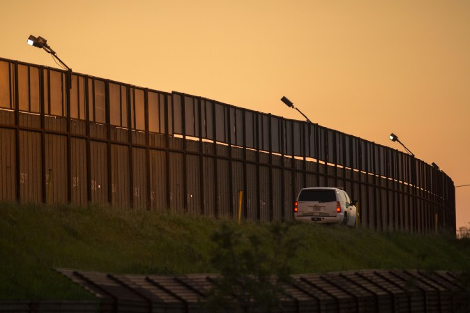 A border patrol agent drives along the US- Mexico border crossing on January 26, 2017 in San Ysidro, California. (DAVID MCNEW/AFP/Getty Images)