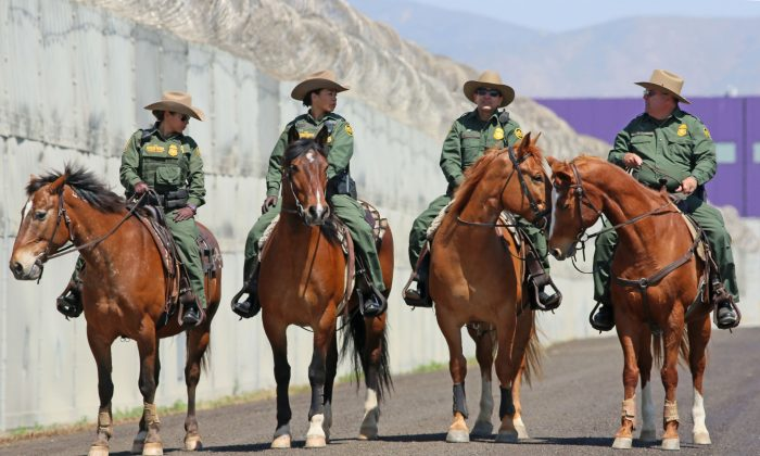 Mounted Border Patrol agents on horseback along the U.S.-Mexico border in Otay Mesa, California, on April 21, 2017. (Sandy Huffaker/Getty Images)