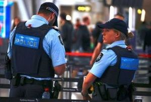 File Photo: Australian Federal Police officers stand near the check-in counters at the Sydney Airport Domestic terminal in Australia, July 30, 2017. (Reuters/David Gray/File photo)