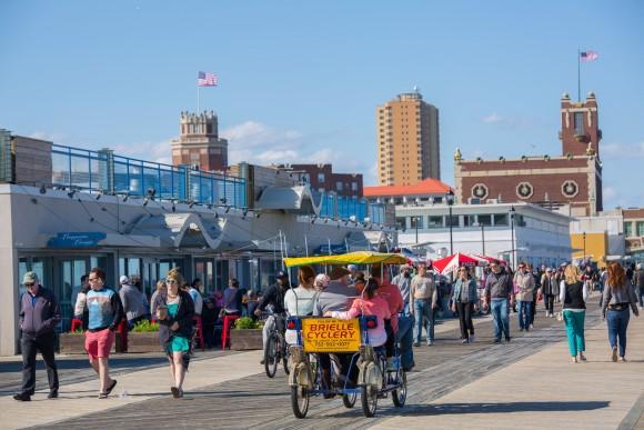 People strolling along the boardwalk. (Asbury Park Boardwalk)
