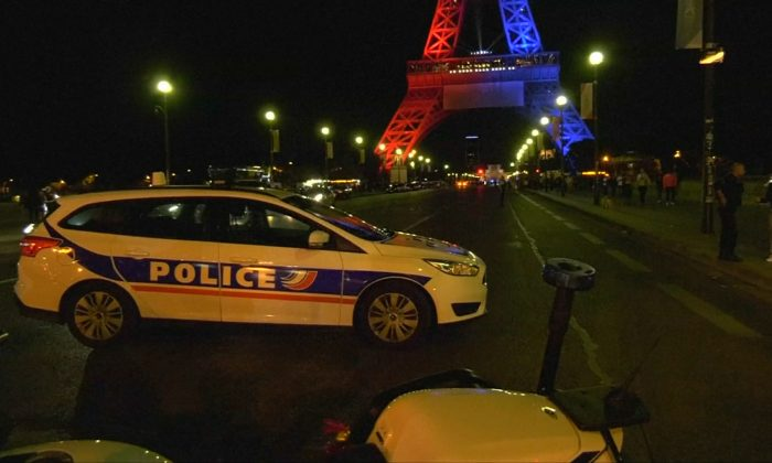 Eiffel Tower evacuated after man with knife tried to force entry on August 6, 2017. (Screenshot from Reuters video.)