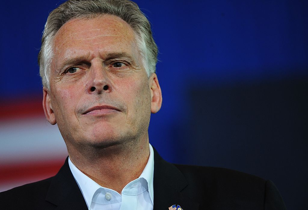 Virginia gubernatorial candidate Terry McAuliffe watches as former President Barack Obama speaks during a campaign rally for McAuliffe at Washington-Lee High School in Arlington, Virginia on Nov. 3, 2013. (MANDEL NGAN/AFP/Getty Images)
