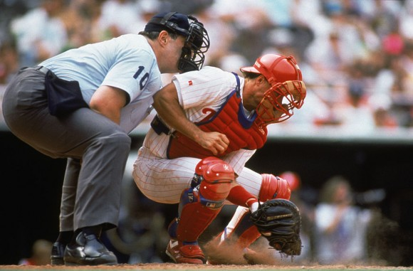 PHILADELPHIA - MAY 24:  Catcher Darren Daulton of the Philadelphia Phillies digs out a low pitch during the MLB game on May 24, 1992 in Philadelphia, Pennsylvania.  (Photo by Jeff Hixon/Getty Images)