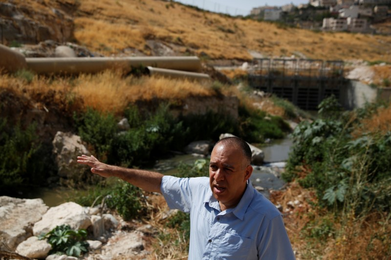 Shony Goldberger, director of the Jerusalem district in Israel's Environmental Protection Ministry speaks during an interview with Reuters as sewage flows in the Kidron Valley, on the outskirts of Jerusalem July 6, 2017. (REUTERS/Ronen Zvulun)