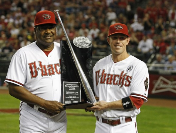 Arizona Diamondbacks' Aaron Hill (R) is presented the Silver Slugger Award by hitting coach Don Baylor before the start of their MLB Opening Day National League baseball game against the St. Louis Cardinals in Phoenix, Arizona on April 1, 2013. (Ralph D. Freso/REUTERS)
