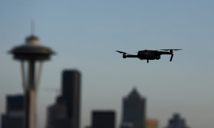 A drone hovers at a viewpoint overlooking the Space Needle and skyline of tech hub Seattle, Washington, U.S. February 11, 2017.  (REUTERS/Chris Helgren)