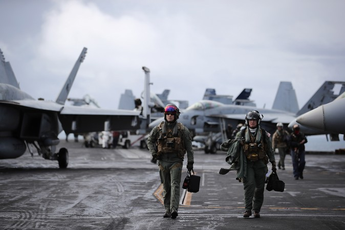 F/A-18 Hornet pilots return from a flight during joint military exercise, Saxon Warrior, aboard the USS George H.W. Bush off the north west coast of the United Kingdom on Aug. 6, 2017. (Dan Kitwood/Getty Images)