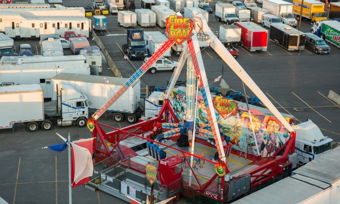 The Fireball ride is barricaded in by semi-trucks at the Ohio State Fair on Aug. 4, 2017 after a man died in the accident on the ride. (Benjamin Chasteen/The Epoch Times)