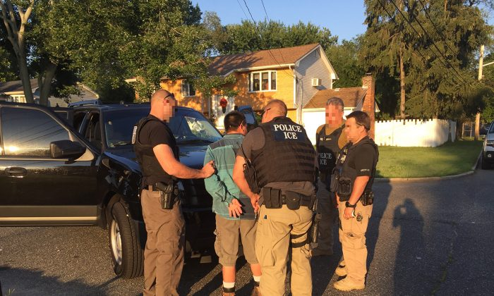 Agents from Immigration and Customs Enforcement (ICE) arrest a sex offender on Long Island, N.Y., during a 10-day operation finishing Aug. 3, 2017. (Courtesy of ICE)