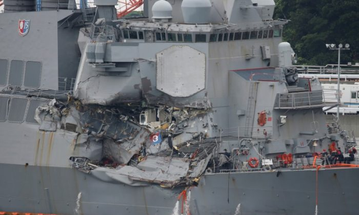 File photo: The Arleigh Burke-class guided-missile destroyer USS Fitzgerald, damaged by colliding with a Philippine-flagged merchant vessel, is seen at the U.S. naval base in Yokosuka,, Japan June 18, 2017. (Reuters/Toru Hanai/File Photo)