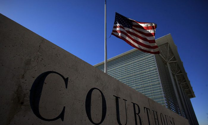 A flag flies outside a courthouse in Phoenix, Arizona.  (Photo by Eric Thayer/Getty Images)