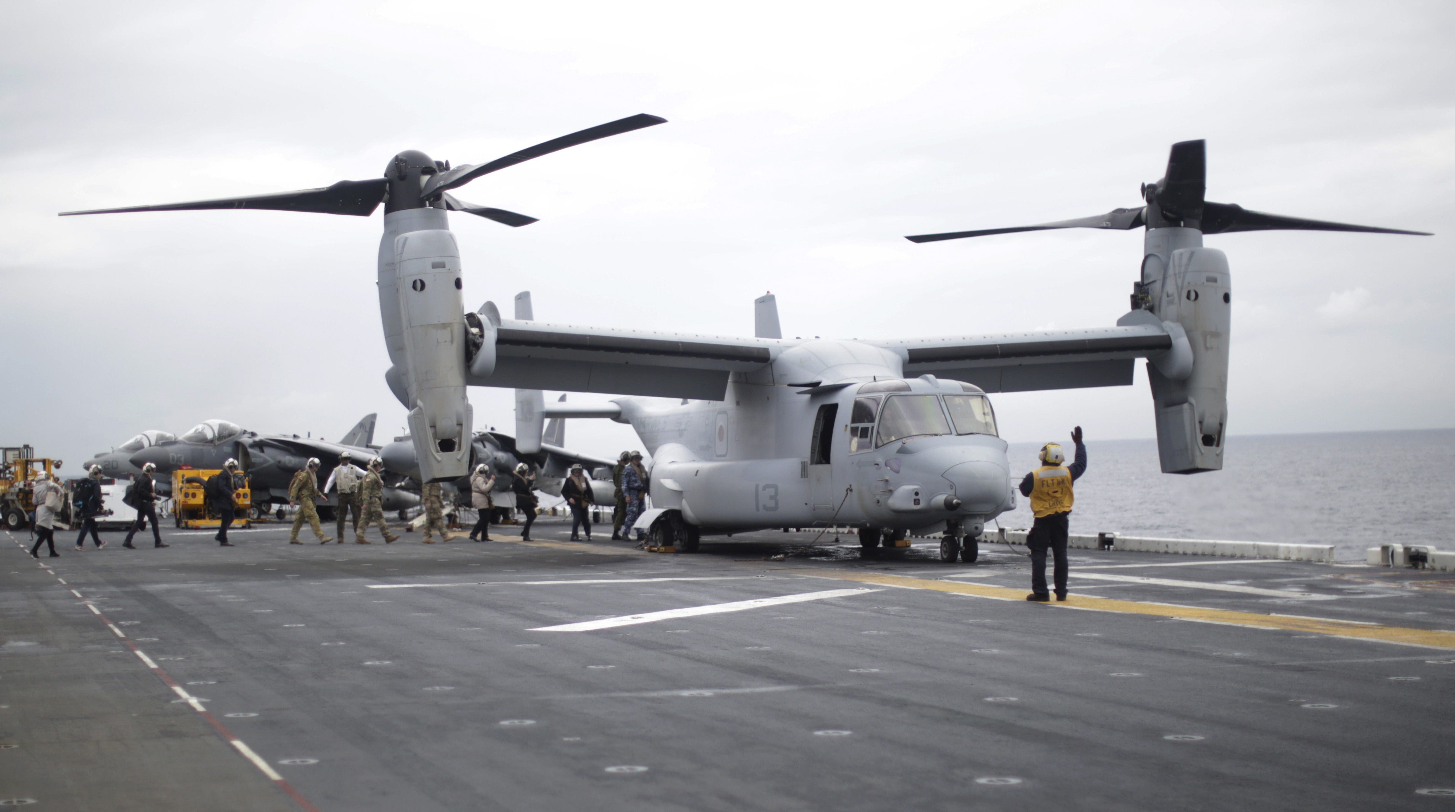 Participants in a ceremony marking the start of Talisman Saber 2017, a biennial joint military exercise between the United States and Australia, board a US Marines MV-22B Osprey Aircraft on the deck of the USS Bonhomme Richard amphibious assault ship off the coast of Sydney on June 29, 2017.  / AFP PHOTO / POOL / JASON REED        (Photo credit should read JASON REED/AFP/Getty Images)