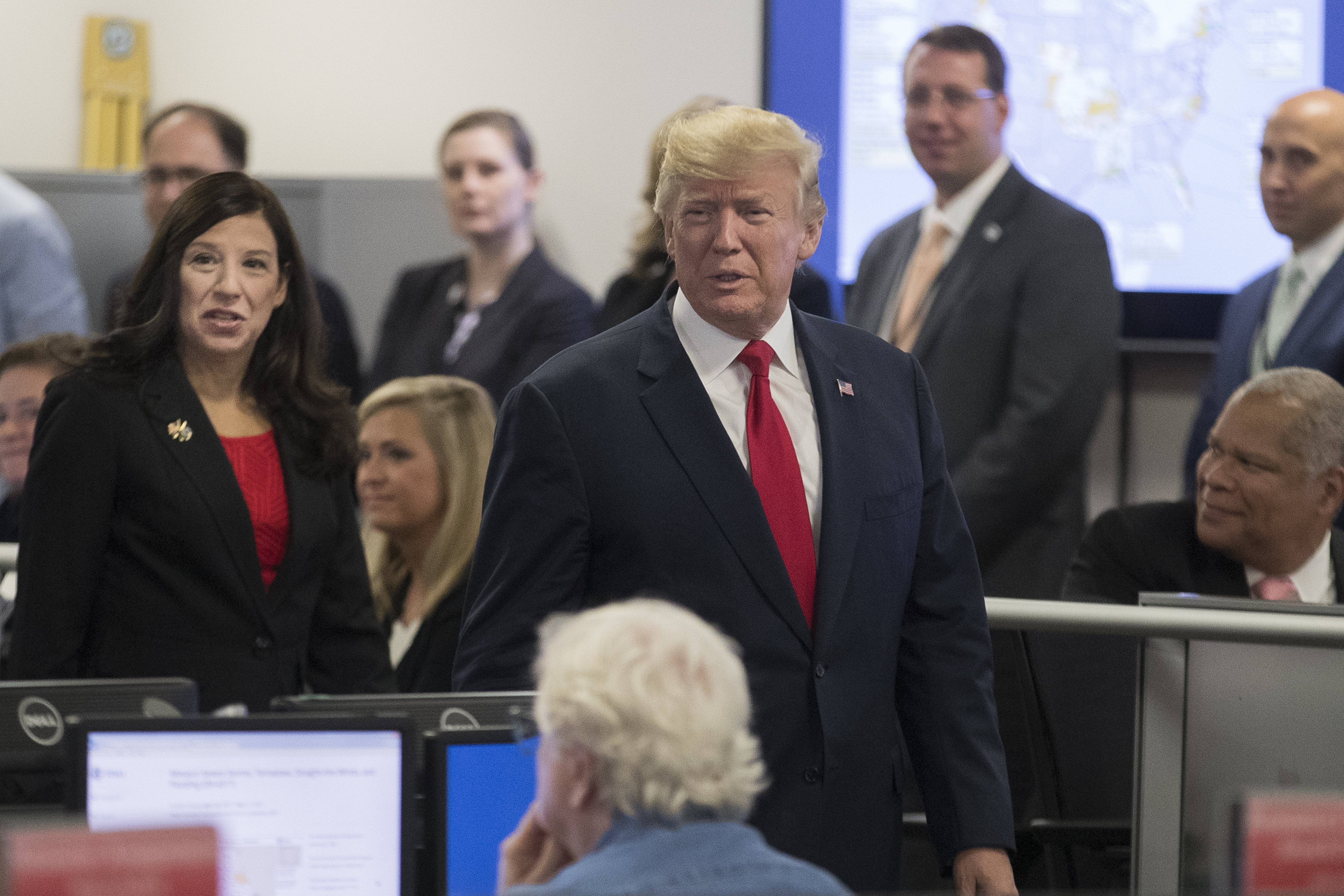 President Donald Trump visits the command center of the Federal Emergency Management Agency (FEMA) headquarters, beside Acting Director of the Department of Homeland Security Elaine Duke (L), in Washington on Aug. 4, 2017. (Michael Reynolds - Pool/Getty Images)
