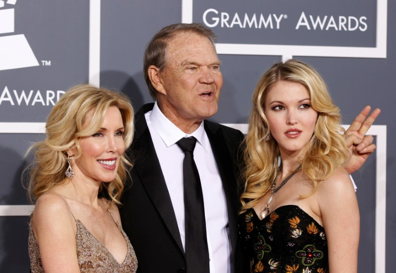 Glen Campbell with his wife Kim (L) and daughter Ashley arrive at the 54th annual Grammy Awards in Los Angeles, Calif., on Feb. 12, 2012. (REUTERS/Danny Moloshok)