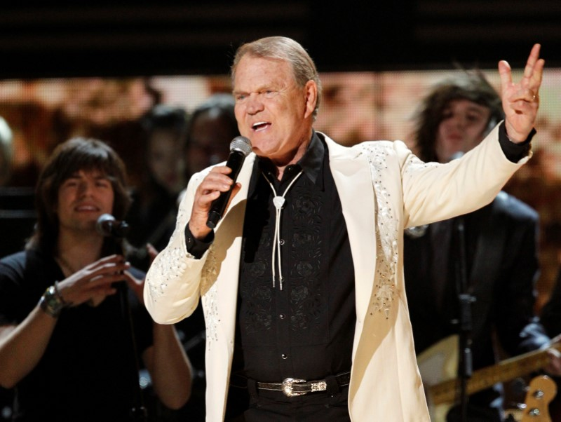 """Glen Campbell sings """"Rhinestone Cowboy"""" during his tribute at the 54th annual Grammy Awards in Los Angeles, Calif.m on Feb. 12, 2012. (REUTERS/Mario Anzuoni)"""
