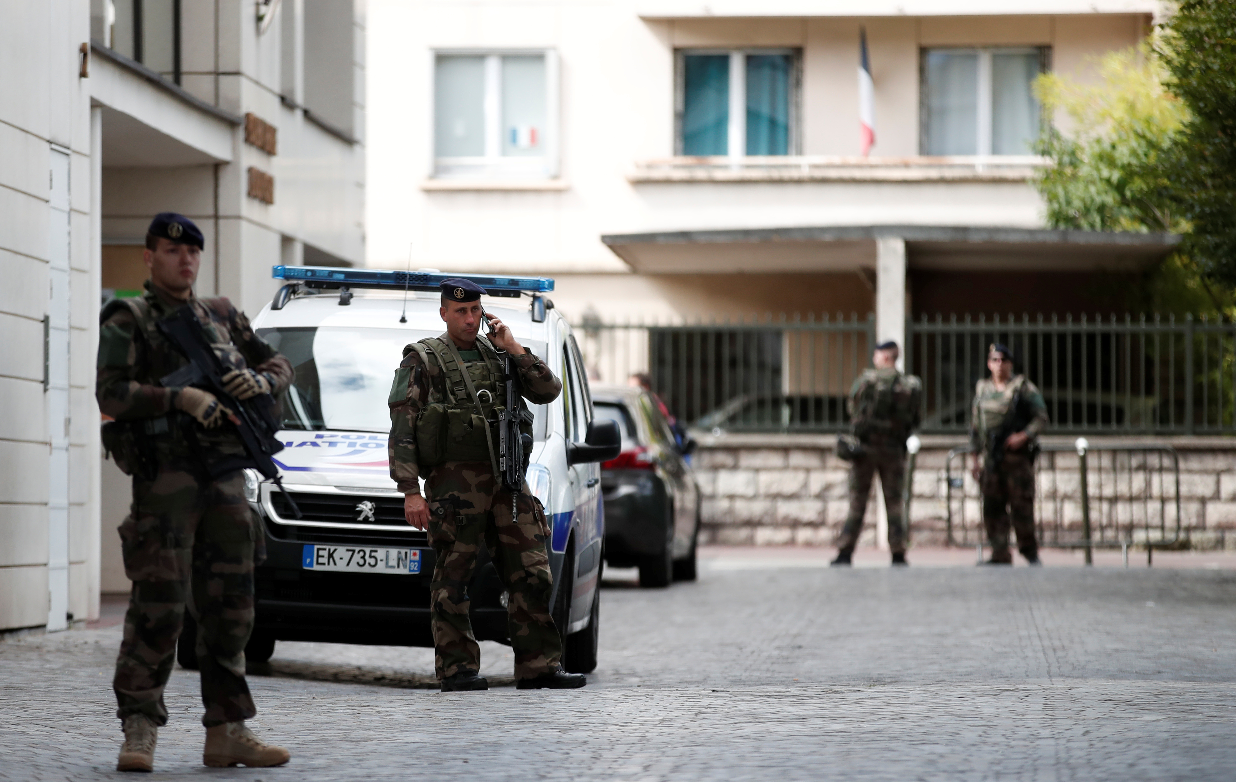Armed soldiers secure the scene where French soliders were hit and injured by a vehicle in the western Paris suburb of Levallois-Perret, France, August 9, 2017.     REUTERS/Benoit Tessier