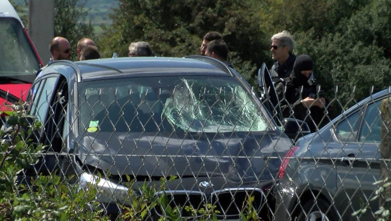 A still image taken from a video shows French police who surround a BMW car with several bullet impacts at the scene where the man suspected of ramming a car into a group of soldiers on Wednesday in the Paris suburb of Levallois-Perret was shot and arrested on the A16 motorway, near Marquise, France on Aug. 9, 2017. (REUTERS/Reuters TV)
