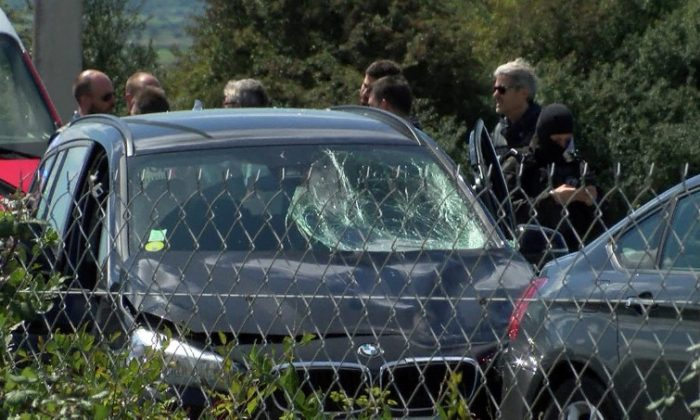 A still image taken from a video shows French police who surround a BMW car with several bullet impacts at the scene where the man suspected of ramming a car into a group of soldiers on Wednesday in the Paris suburb of Levallois-Perret was shot and arrested on the A16 motorway, near Marquise, France, August 9, 2017.  (REUTERS/Reuters TV)